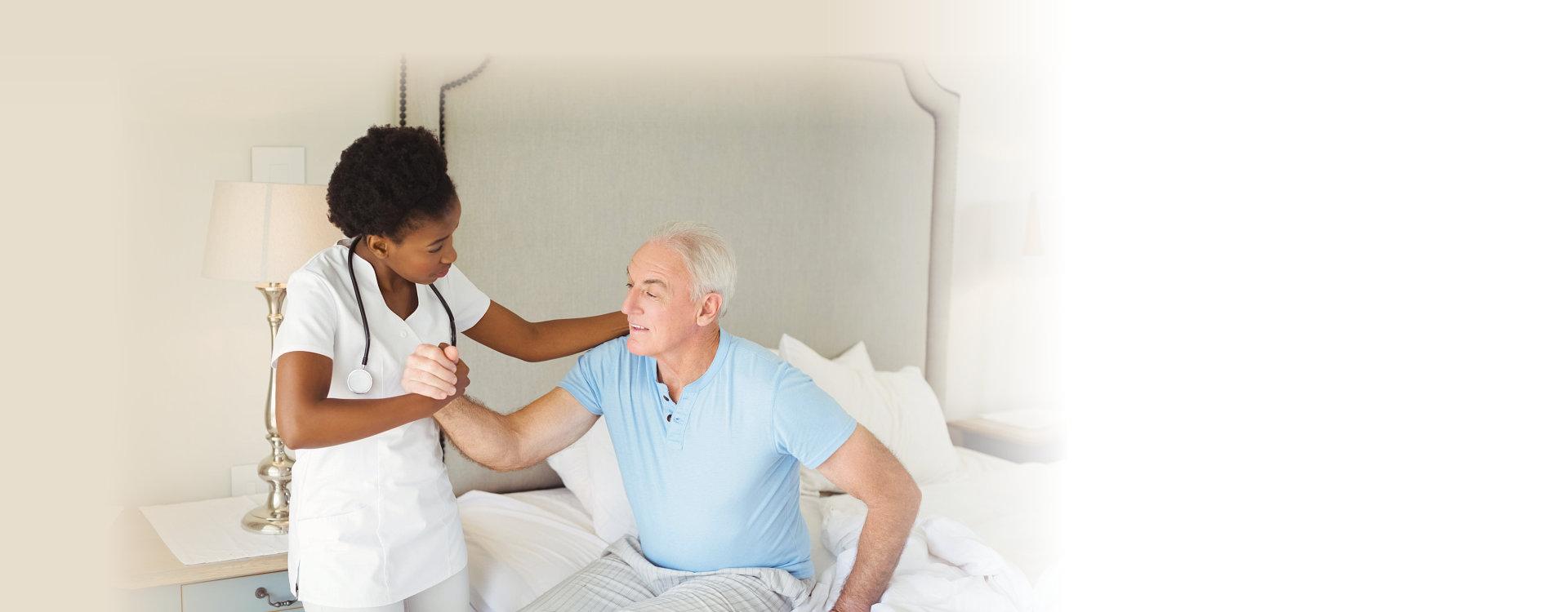 Nurse examining a senior man