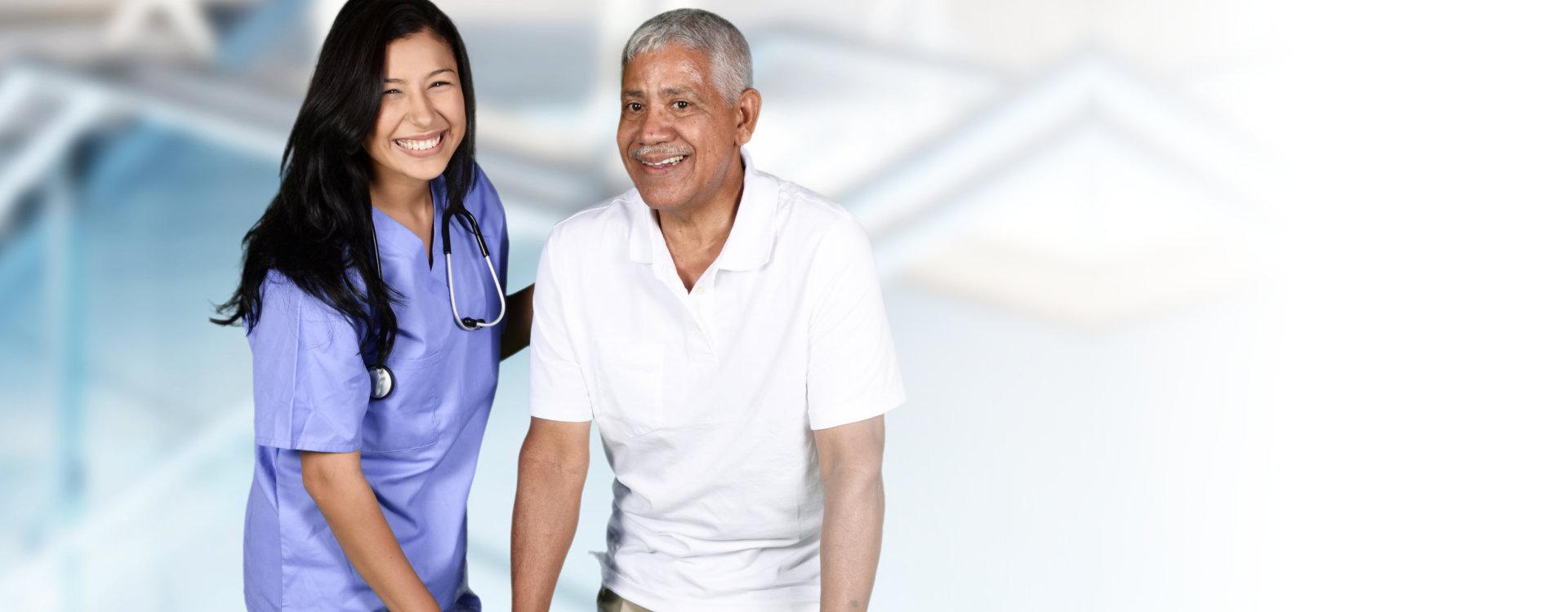 Nurse helping elder man at hospital gym