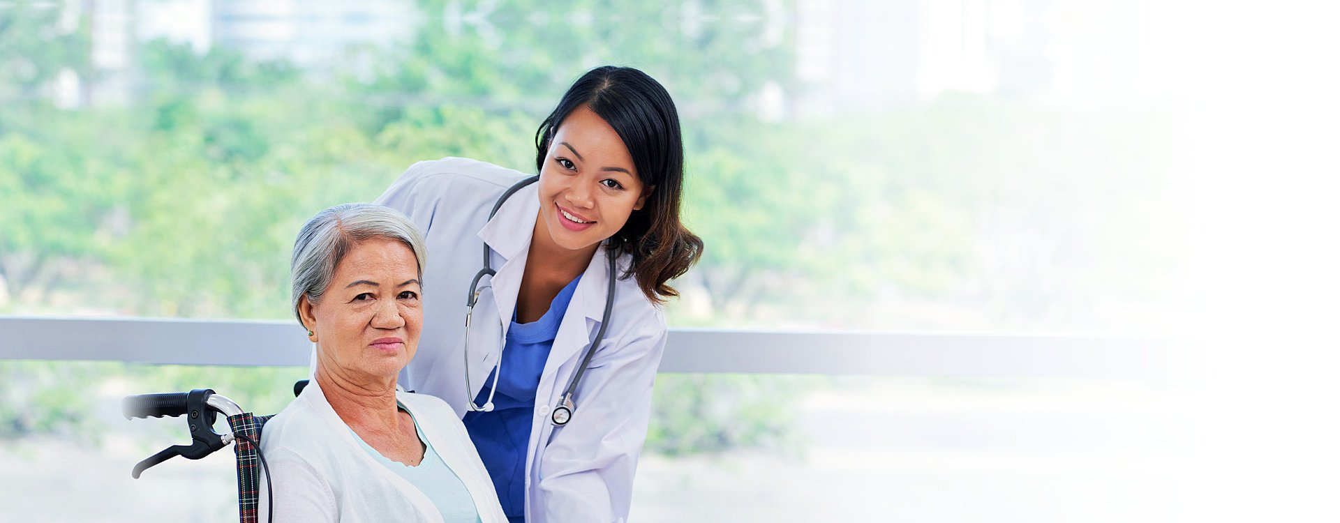 Doctor caring about elderly woman