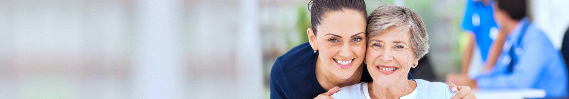 portrait of caregiver and senior woman smiling